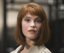 Image: What is the name of the Bond girl drowned in oil, played by Gemma Arterton in QUANTUM OF SOLACE?